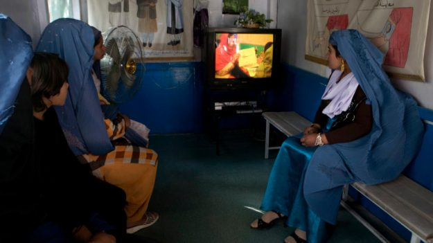 Afghan women watch an informative documentary about the prevention of unwanted births at Marie Stopes International Clinic in Kabul, Afghanistan, on Wednesday, Oct. 14, 2009. Increased contraceptive use has led to fewer abortions worldwide, but deaths from unsafe abortion remain a severe problem, killing 70,000 women a year, a research institute reported Tuesday in a major global survey. (AP Photo/Farzana Wahidy)